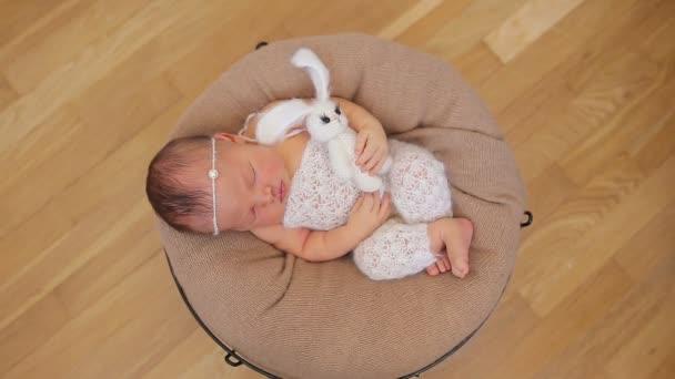 Cute newborn baby girl sleeping in basket