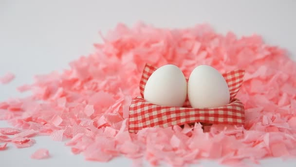 White Easter Eggs On A Pink Background