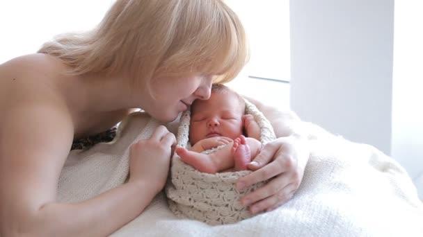 Mom and her Tiny Newborn Baby
