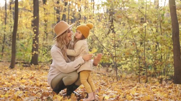 Lovely mother with kids in autumn nature