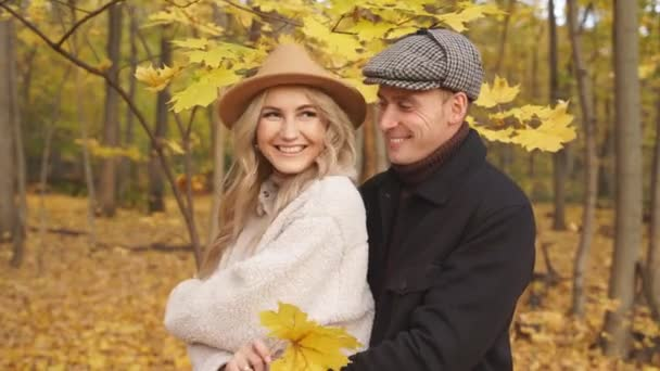Happy caucasian family couple enjoy being in autumn nature.