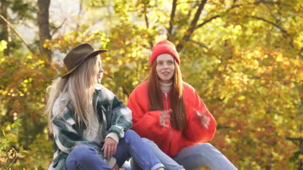 Two happy female travellers enjoy in nature.