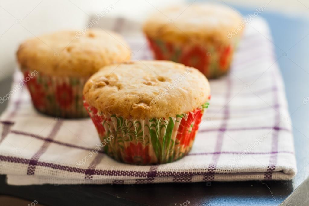 Vanilla Muffins cupcakes with white chocolate on a towel