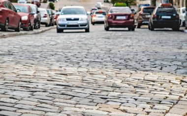 cars go on the road cobbles