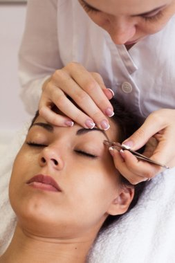 Pretty young woman in cosmetic salon. Close up.