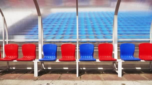 Sezení pro trenéry a hráči na stadionu