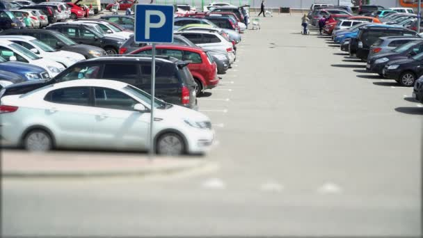 Parking is in front of the hypermarket with buyers