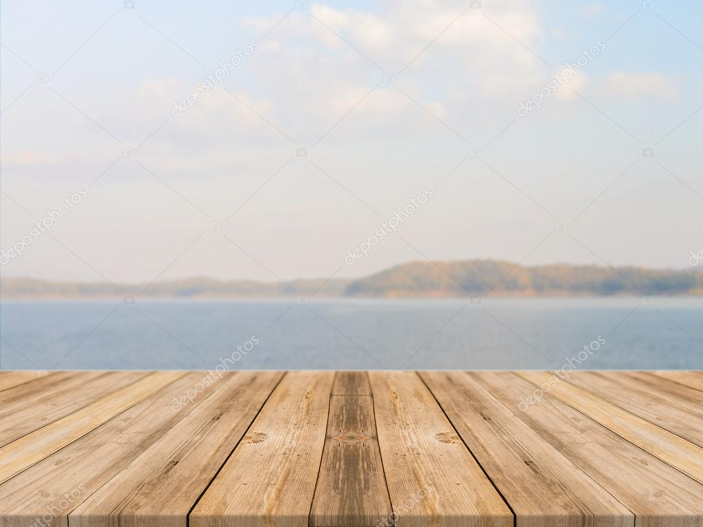 wood floor perspective. vintage wooden board empty table in front of blue sea \u0026 sky background. perspective wood floor over and - can be used for display or montage your s
