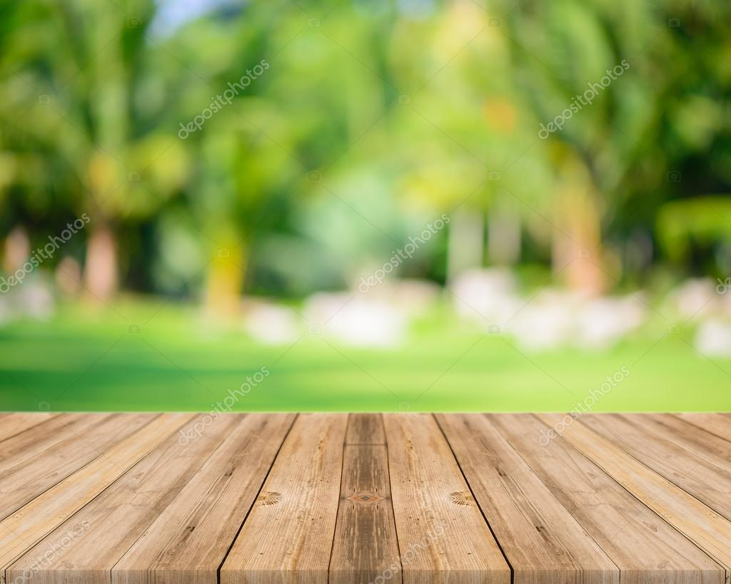 Wooden board empty table in front of blurred background. Perspective grey wood over blur trees in forest - can be used for display or montage your products. spring season.
