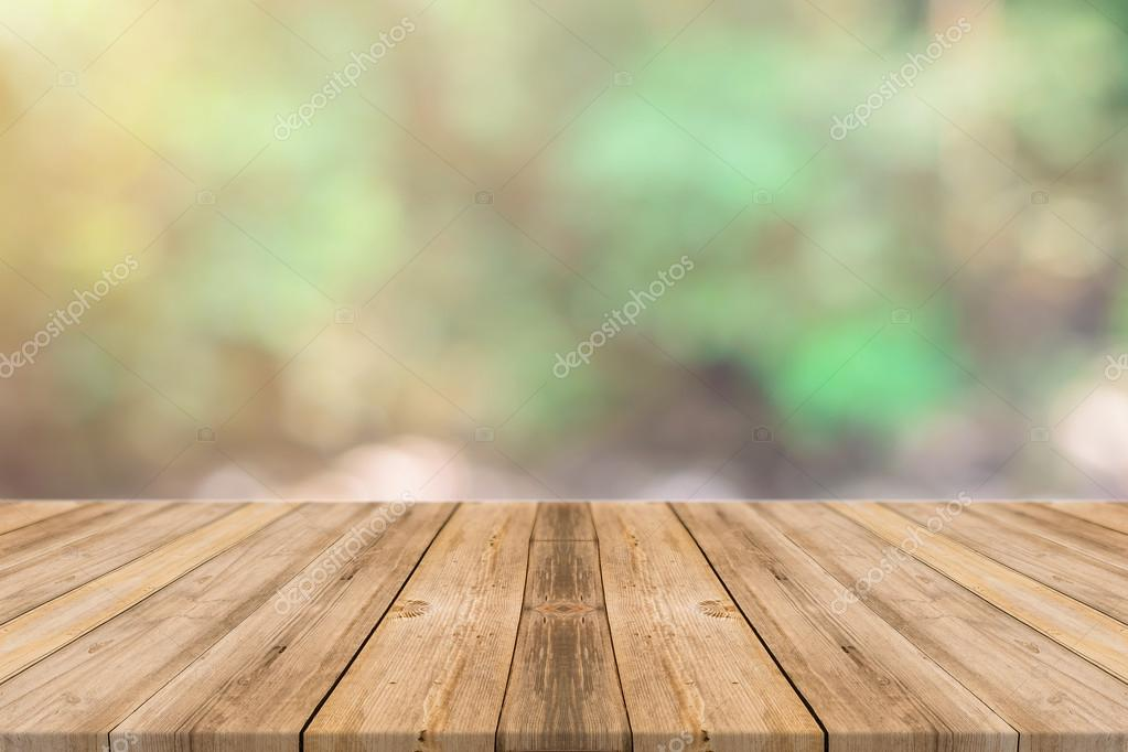 Wooden board empty table in front of blurred background. Perspective brown wood over blur trees in forest - can be used for display or montage your products. spring season.