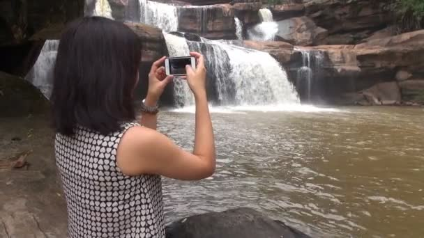 Beautiful Young Woman Takes Pictures Of Nature With Smartphone
