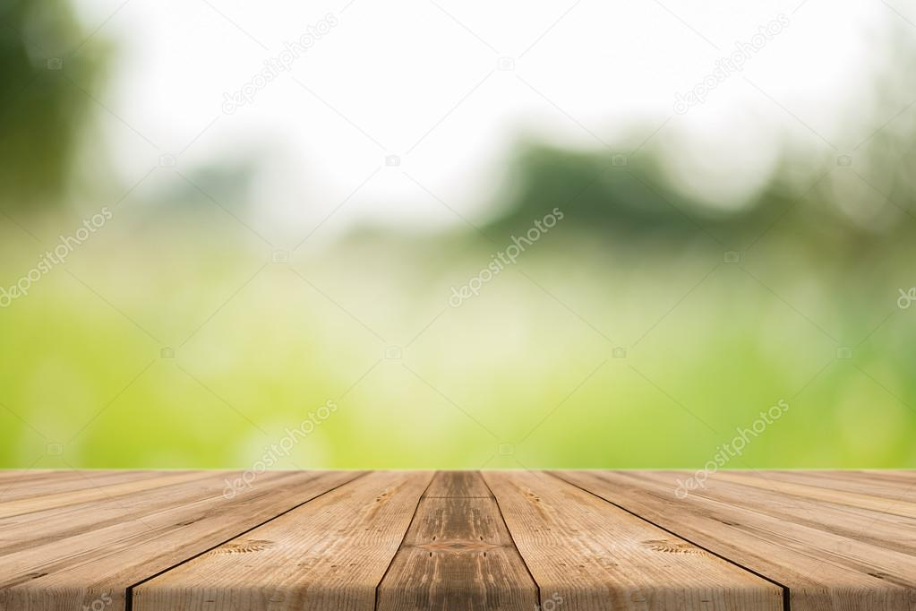 Wooden board empty table in front of blurred background. Perspective brown wood over blur trees in forest - can be used for display or montage or mock up your products. your products.