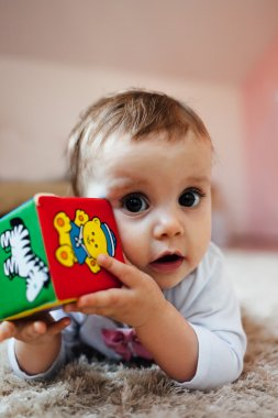 Baby playing with a toy