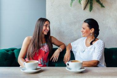Two women talking in cafe