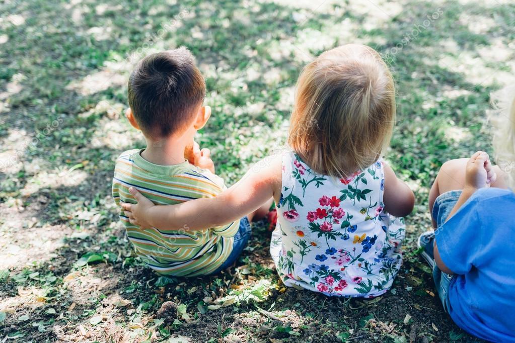 Children sitting in the grass