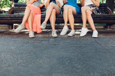 Girls sitting on a park bench