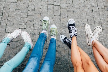 Girls are having fun with feet and shoes