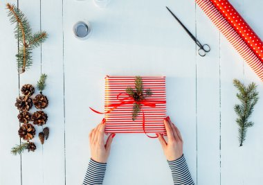 Present wrapped in red paper on a wooden background