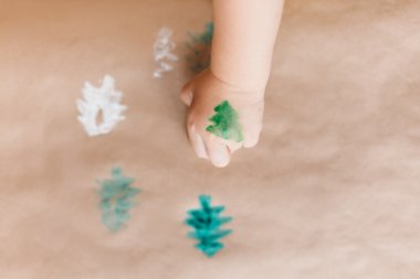 Christmas tree on the child's hand