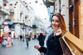 Fényképek szép nő, könyv bevásárló táskák