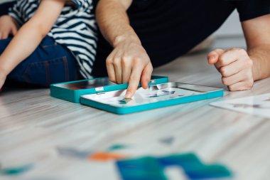 Closeup of father teaching child