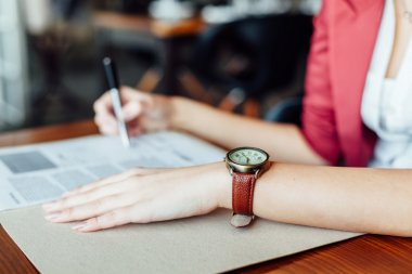 Woman with leather wristwatch in closeup