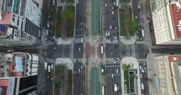 Aerial Drone scene of  9 de Julio main Avenue, 9 of july in Buenos Aires, Argentina. Traffic and people going to work.