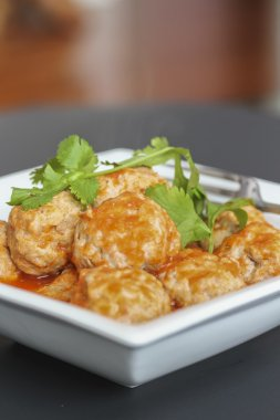 Vietnamese pork dumpling balls in tomato sauce served with bread