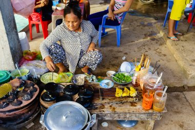Long Hai, Vietnam - Dec 29, 2014: Vietnamese fast food (Banh Xeo and Banh Can) vendors at Long Hai fish market on early morning, Long Hai, Vung Tau, Vietnam
