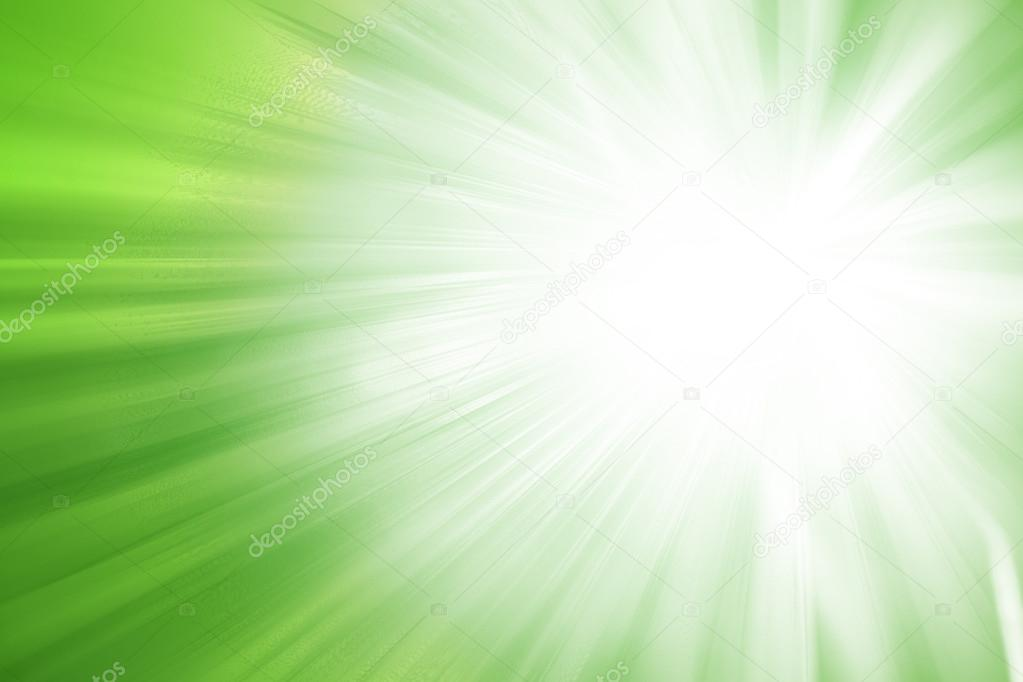 Green glitter sparkle defocused rays lights abstract background.
