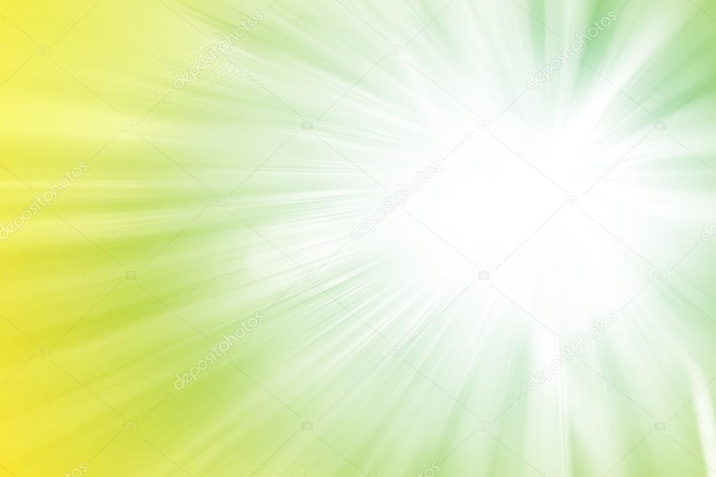Green and yellow glitter sparkle defocused rays lights abstract background.
