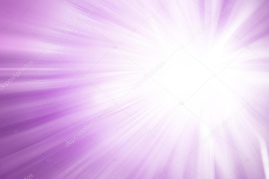 Purple glitter sparkle defocused rays lights abstract background.