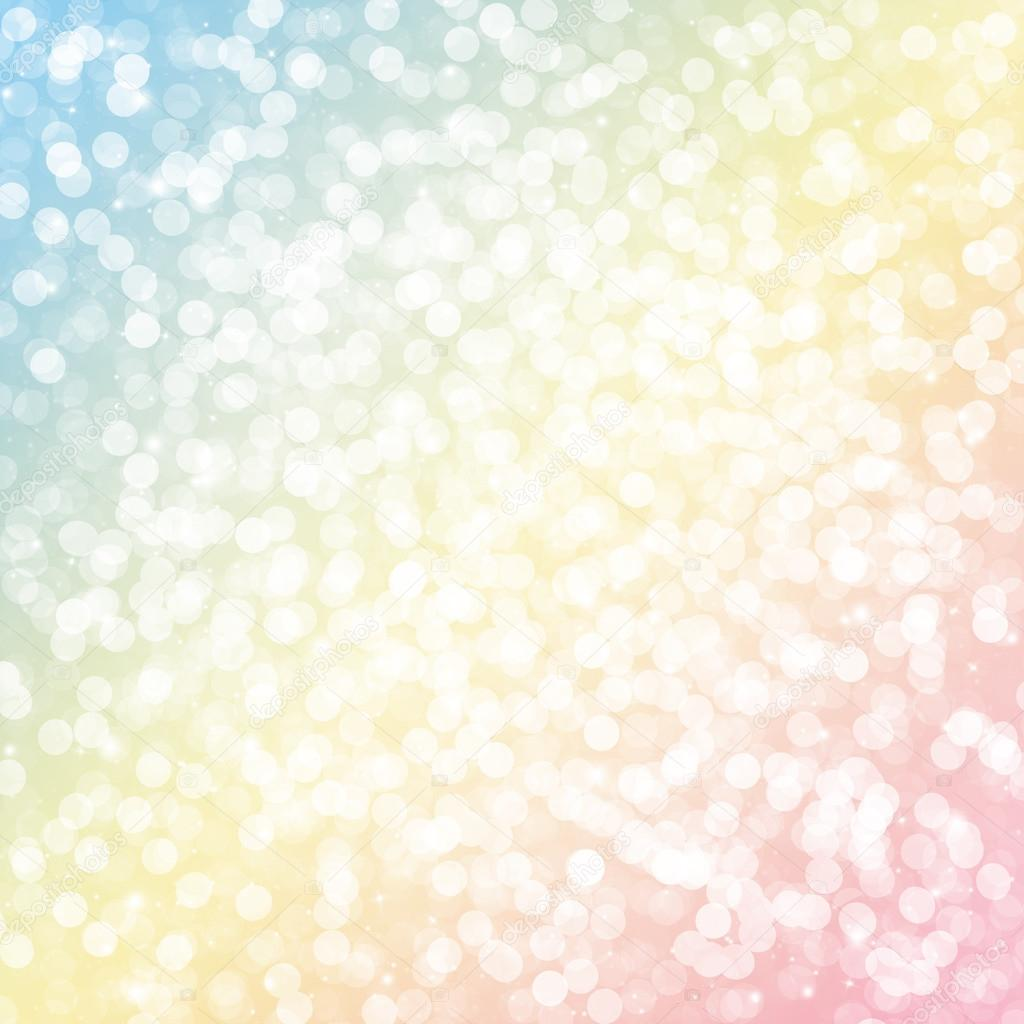 Yellow blue and pink bokeh glitter defocused lights