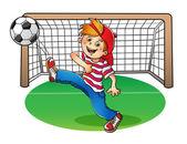 Fényképek A fiú egy piros sapkát rúg a futball-labda