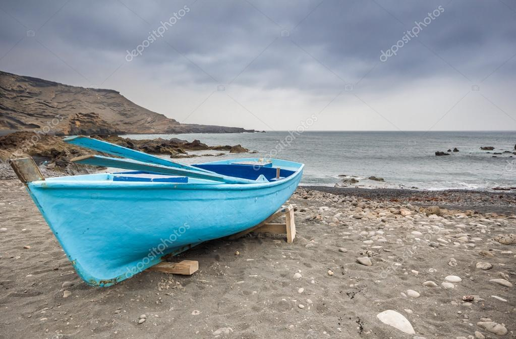 boat moored on the beach before the storm