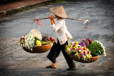 Vietnam florist vendor on hanoi street, Vietnam.  This is small market for vendors of hanoi, vietnam.