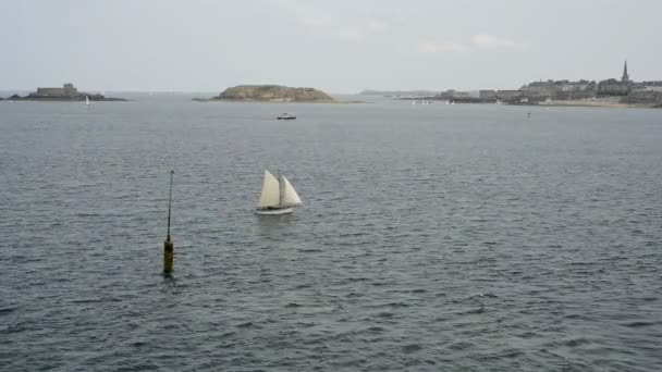 sailboat at sea, view from the fortress of St Malo, France