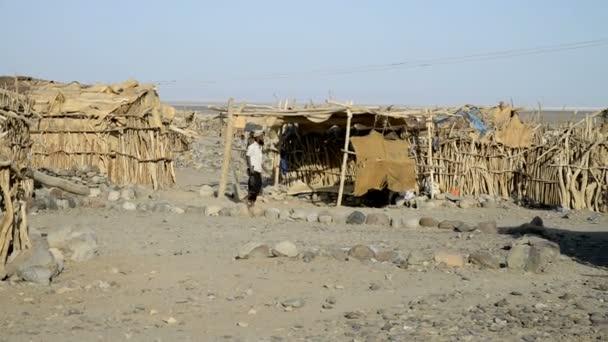 People walking along their shacks