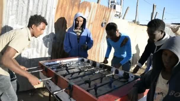 Boys playing table football