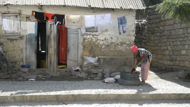 Woman wash the clothes