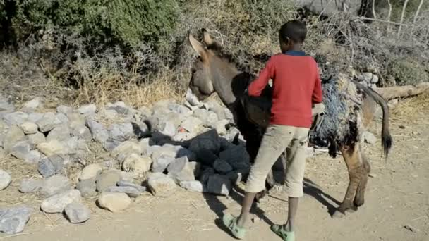 A boy taking out a stones