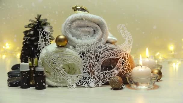 Spa salon items and attributes with christmas decorations in mild snowfall, beautiful christmas landscape with spa elements 4K