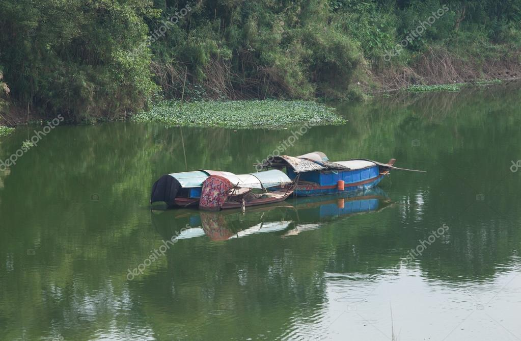 traditional asian fishing boat floating