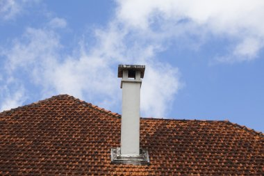 Chimney of an old house on blue sky stock vector