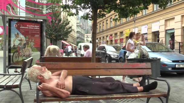 BRNO, CZECH REPUBLIC - AUGUST 11, 2015: Authentic emotion homeless man asleep on a bench