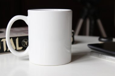 White cup on a table