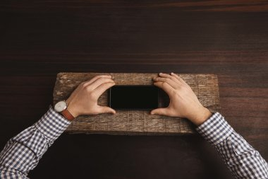 Accountant hands hold his smart phone