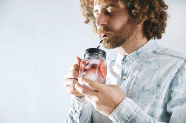 man enjoys fresh lemonade