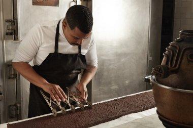 chief use professional separator to split chocolate cake