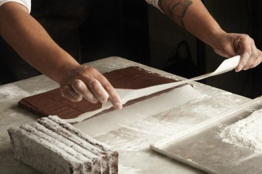 man cooks chocolate cakes